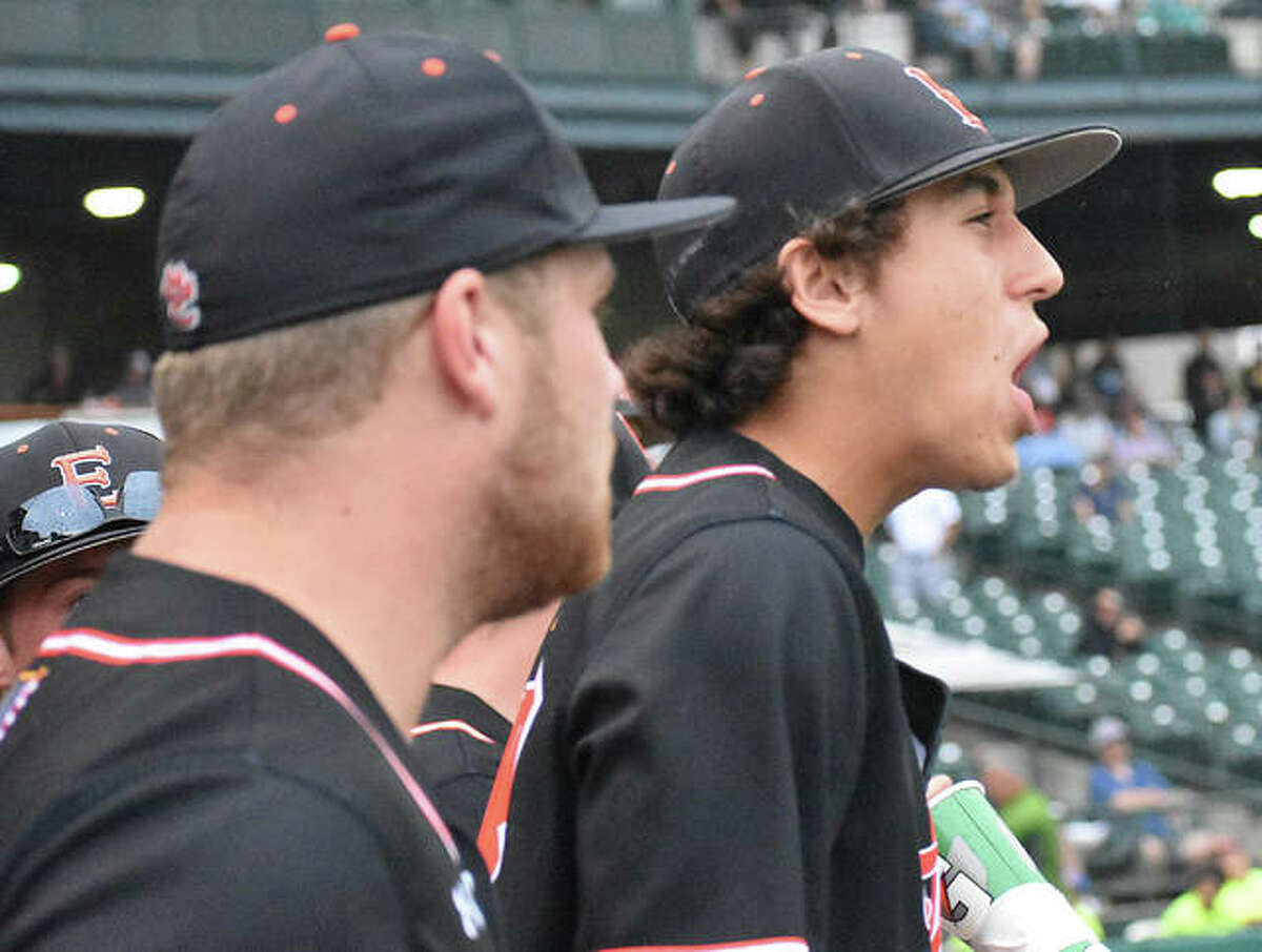 Edwardsville's Ty Berumen, back, celebrates in the dugout during the Class 4A state championship game in Joliet.