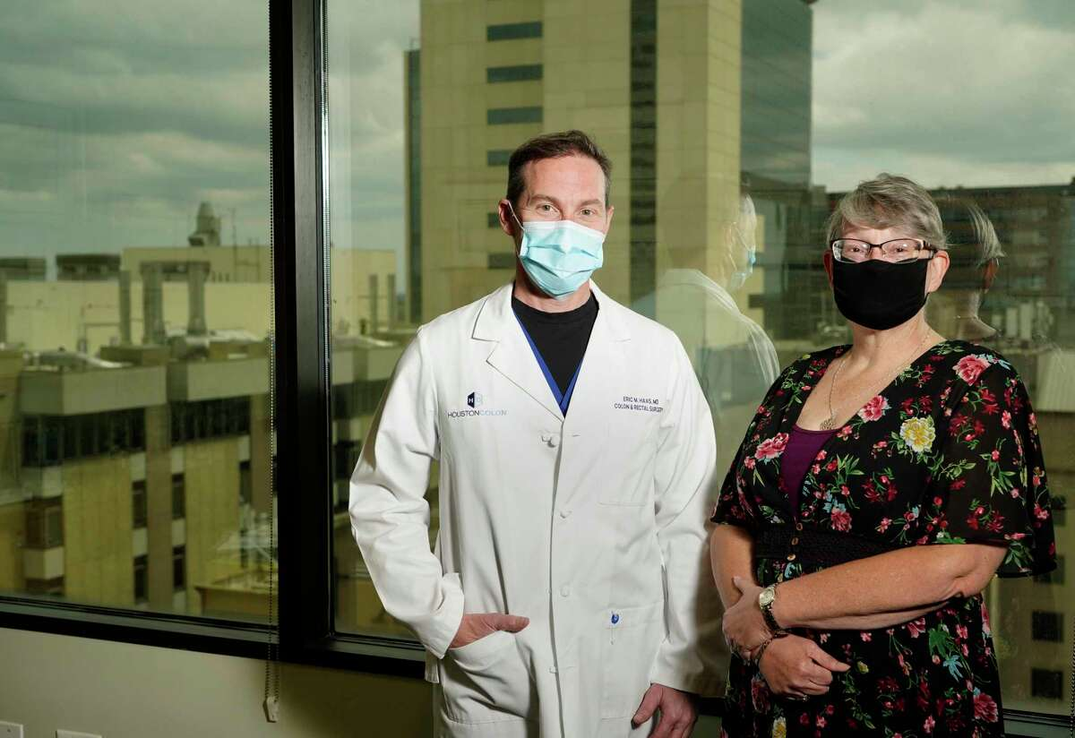 Dr. Eric Haas, left, and Yvonne Vives, right, are shown at Houston Colon, 6560 Fannin St., Monday, March 22, 2021 in Houston. Her treatment plan required her to have colorectal surgery and luckily, she was referred to local trailblazer, Dr. Eric Haas of Houston Colon, who performed a new innovative surgical procedure at HCA Houston Healthcare Medical Center.