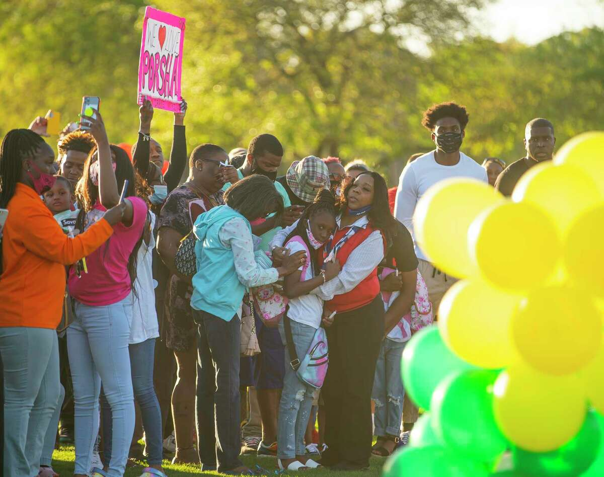 Family and friends of Porsha Branch, who was killed by a drunk driver along with her three young children, Drake, King and Messiah, watch as balloons they released float away during a vigil for the family on Thursday evening, March 25, 2021, at Meyer Park in Spring.