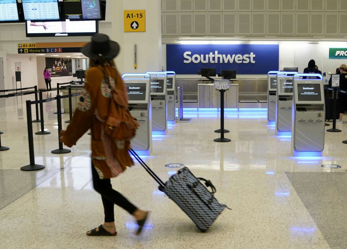 The Southwest Airline counter in Terminal A at George Bush Intercontinental Airport is shown Friday, April 9, 2021 in Houston. The growing number of commercial airline travelers is starting to lift jet fuel demand ahead of the peak summer travel season, according to a report from the Energy Department.