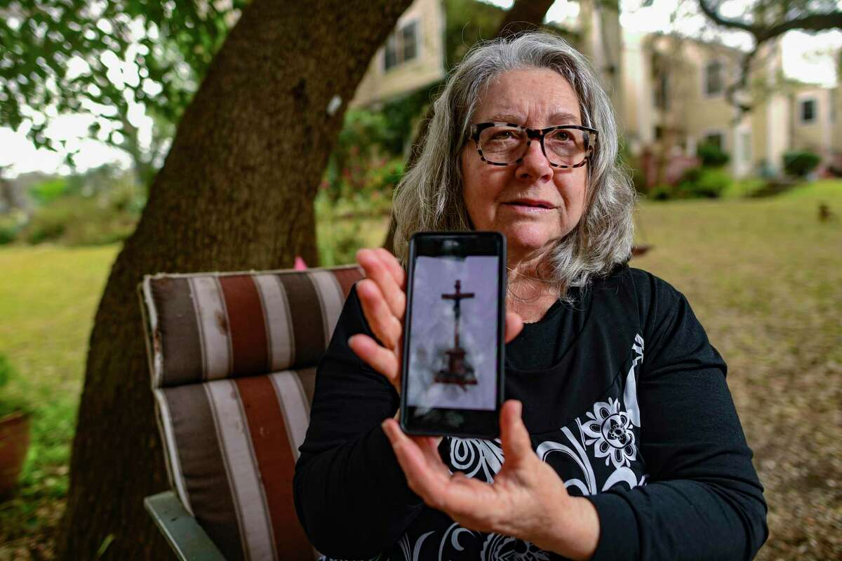 Agnes Rosza displays a picture of a cross that was carried by her aunt, Rose Helen Safran, when she escaped the communist forces that invaded Budapest, on Tuesday, Feb. 10, 2021. Safran and her husband, Stephen, became leaders of the Hungarian community in San Antonio.