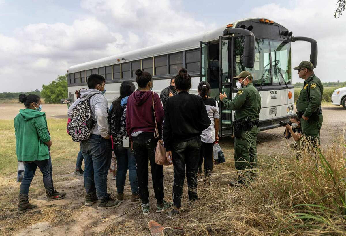 LA JOYA, TEXAS - APRIL 11: Central American immigrants wait to be transported to a processing center by U.S. Border Patrol agents near the border with Mexico on April 11, 2021 in La Joya, Texas. A surge of immigrants crossing the southern border, including record numbers of children, continues. (Photo by John Moore/Getty Images)