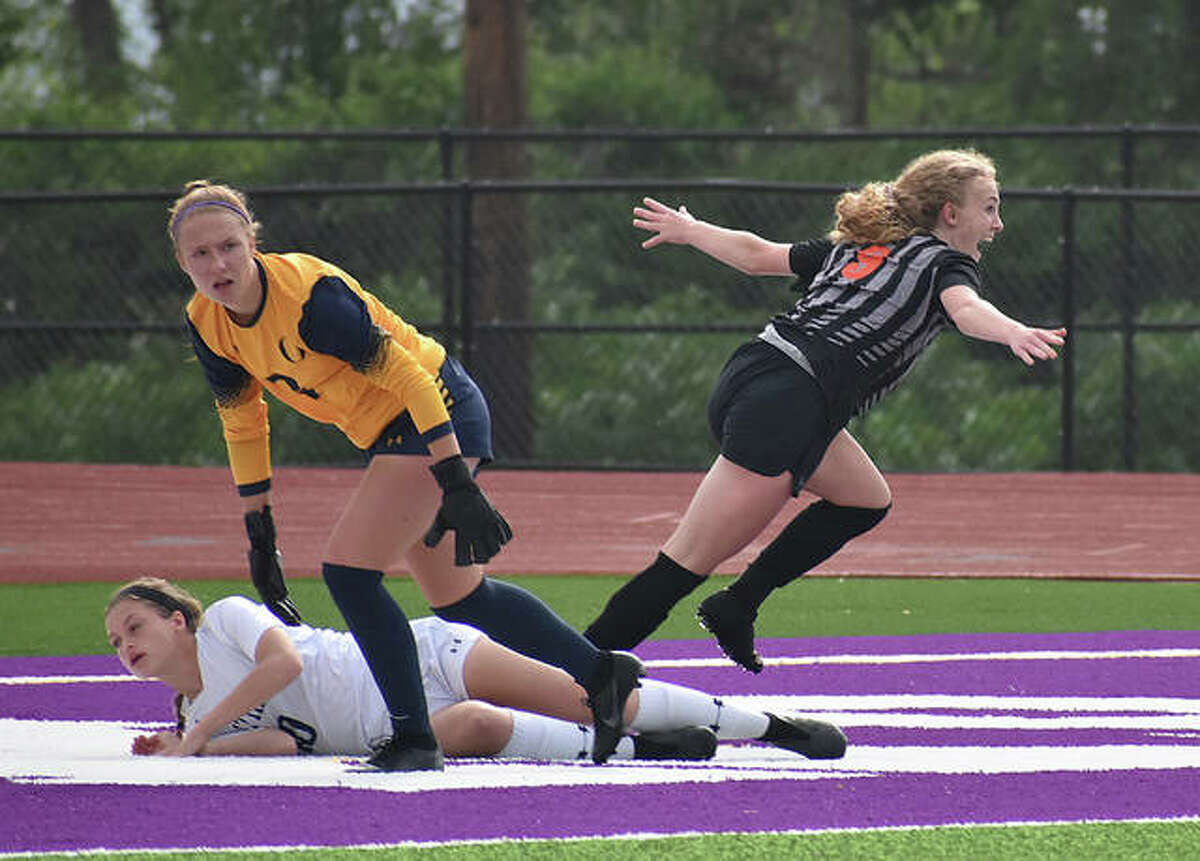 Edwardsville's Payton Federmann, right, celebrates after scoring the game's first goal in the sixth minute against O'Fallon in the sectional semifinals in 2019.