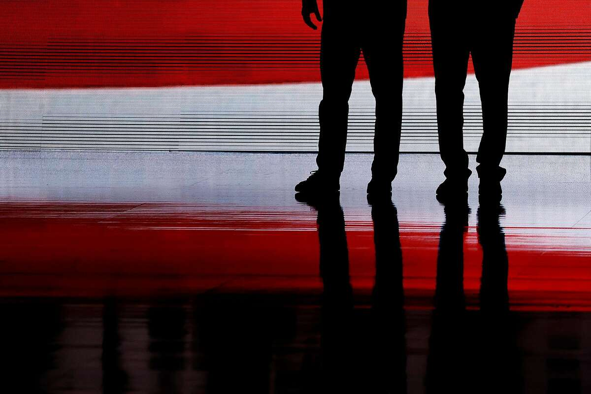 The American flag is reflected on the court before the NCAA men's basketball championship game between the Gonzaga Bulldogs and the Baylor Bears at Lucas Oil Stadium in Indianapolis on April 5, 2021.