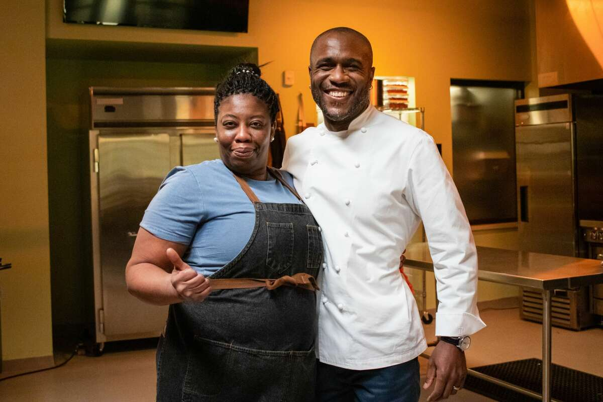 """Kizzy Williams, chef-owner of Allie B's Cozy Kitchen in albany, with Cliff Crooks, host of the new Food Network series """"Chef Boot Camp. Williams is set to appear on the April 29 episode. (Food Network photo.)"""