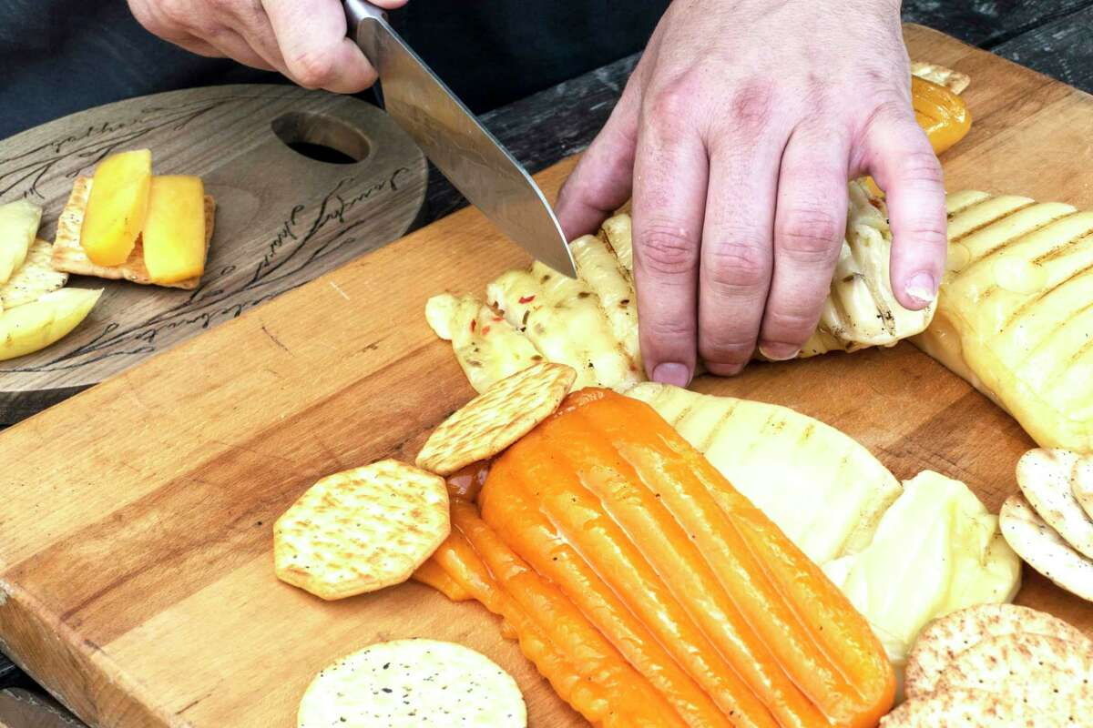 Cold-smoked cheese can be smoked on your backyard grill, sliced and served up on crackers.