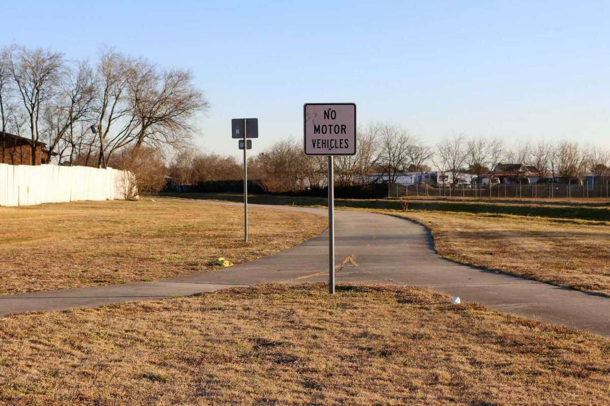 If a hike-and-bike trail is built along Vince Bayou, it could look similar to the existing Strawberry Trail, shown where it ends at Spencer Highway. The two trails would be connected.