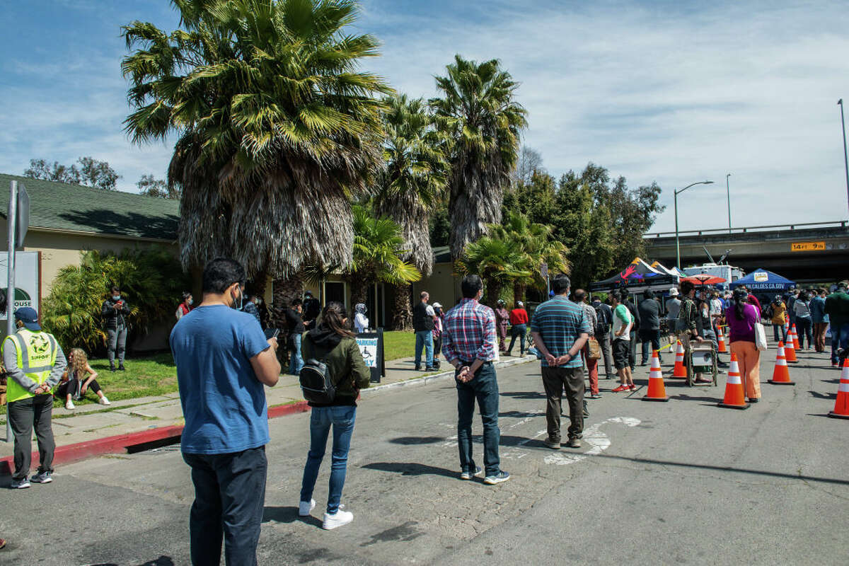Hundreds wait in queue for the Janssen COVID-19 vaccine (Johnson & Johnson) in Oakland, Calif. Beginning April 15, anyone 16 or older will be eligible for the vaccine in California.