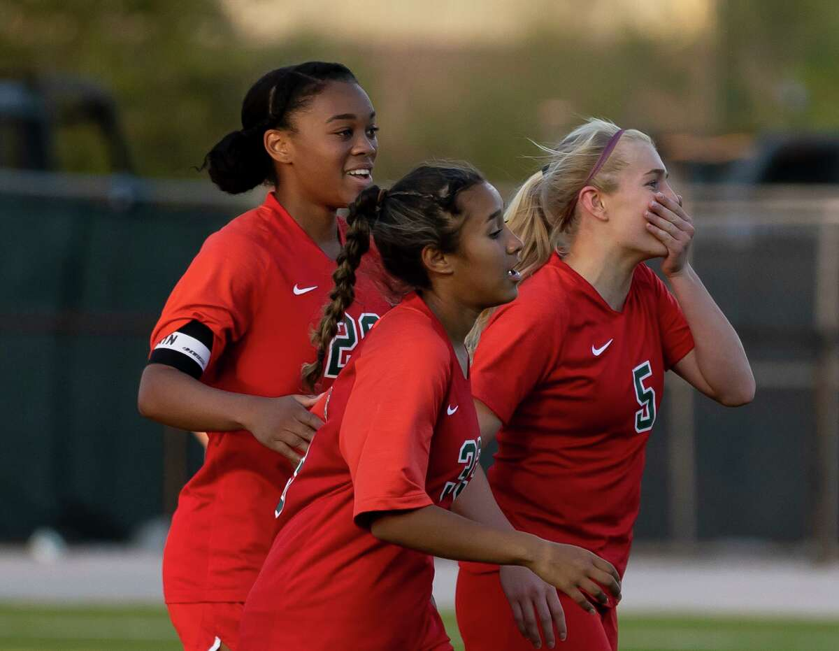 FILE PHOTO - The Woodlands midfielder Courtney Koehler (5) reacts after she scores during the second half of a Region II-6A quarterfinals soccer match against Tomball at Woodforest Bank Stadium, Friday, April 2, 2021, in The Woodlands.