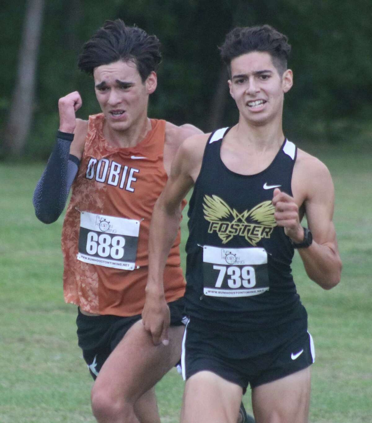 Dobie's Alberto Campa (left) will be the favorite to claim the medalist championship at Friday morning's District 22-6A race. Foster's Caden Cunningham is giving Campa a battle to the finish line.