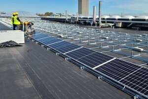 Solar panels are going up on the buildings around the UAlbany podium area.