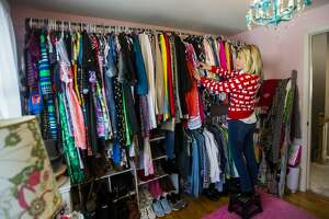 Jodi Bromley displays her vintage clothing collection Tuesday, Feb. 16, 2021 at her home in Midland. (Katy Kildee/kkildee@mdn.net)