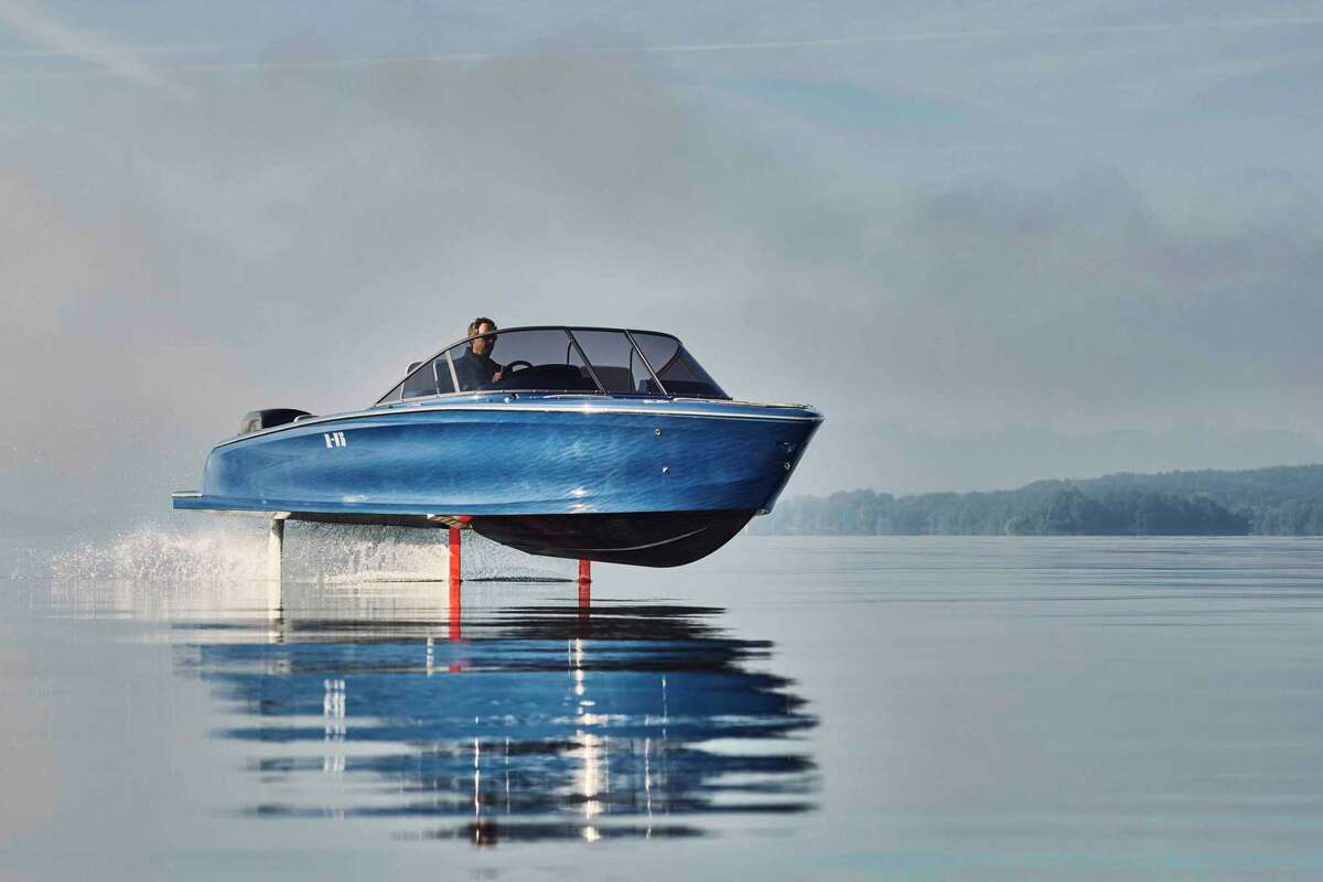 The Candela Seven hydrofoil speed across Lago Maggiore. The speedboat is powered by an electric engine and capable of sustaining 20 knots for 2 1/2 hours, according to the manufacturer.