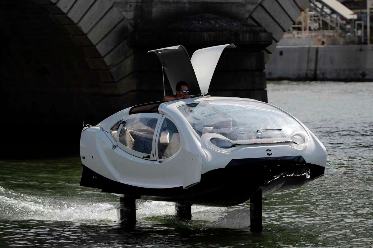 In this photo taken Tuesday Sept. 17, 2019 an hydrofoil boat SeaBubble sails in Paris. Paris is testing out a new form of travel - an eco-friendly bubble-shaped taxi that zips along the water, capable of whisking passengers up and down the Seine River. (AP Photo/Francois Mori)