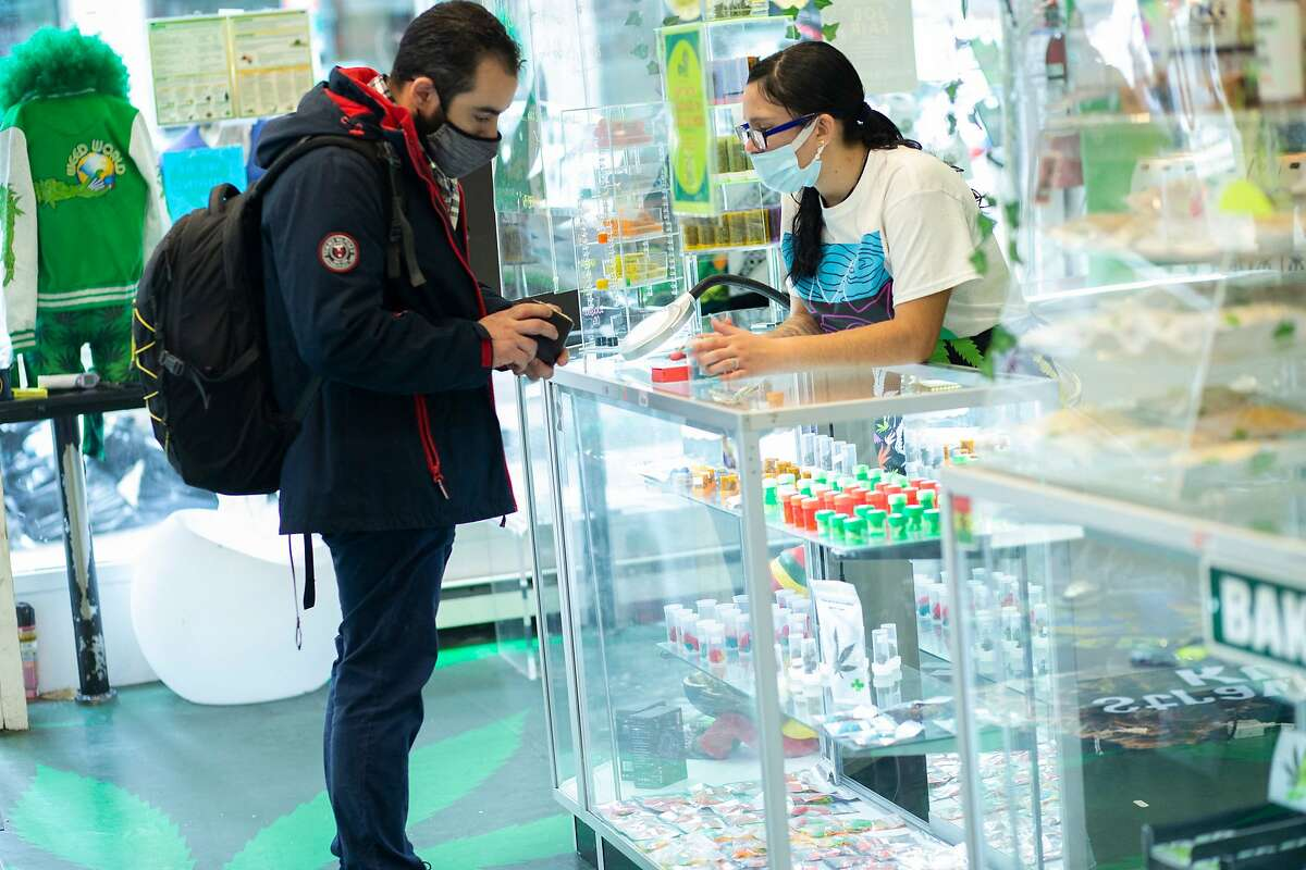 A customer from Connecticut buys marihuana supplies at the Weed World store on March 31, 2021, in New York.
