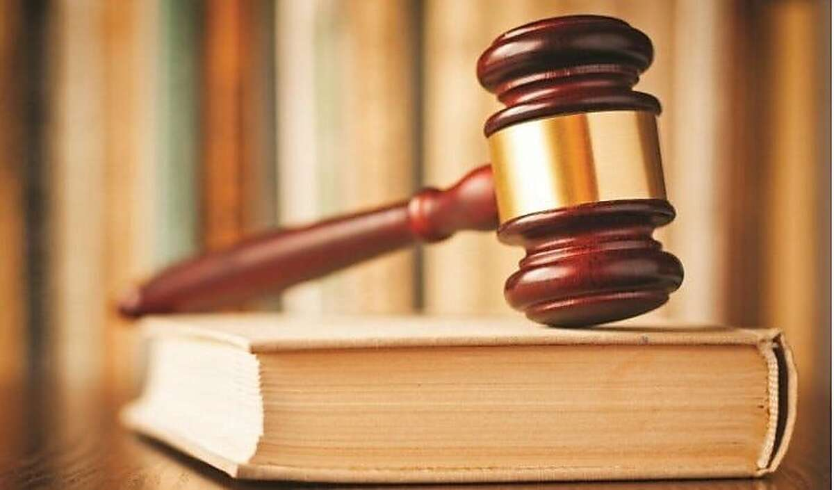 A judge's gavel rests on a law book. A federal jury convicted a man of a hate crime last week after he attacked a Black man with a 9-inch knife while yelling racial slurs on a Santa Cruz street.