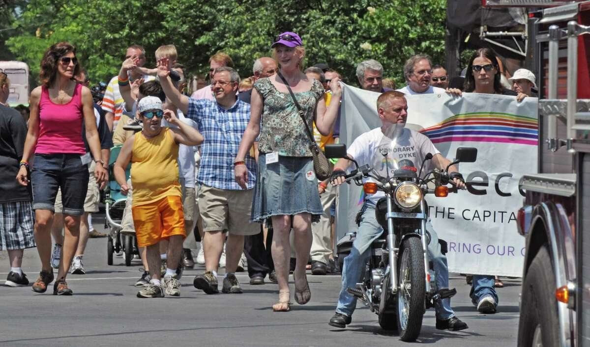 John Tolson of Altamont rides a motorcycle in front of the Pride Center of the Capital Region marchers, on State Street during the 2012 Capital Pride Parade, on Sunday June 10, 2012 in Albany, NY (Philip Kamrass / Times Union)