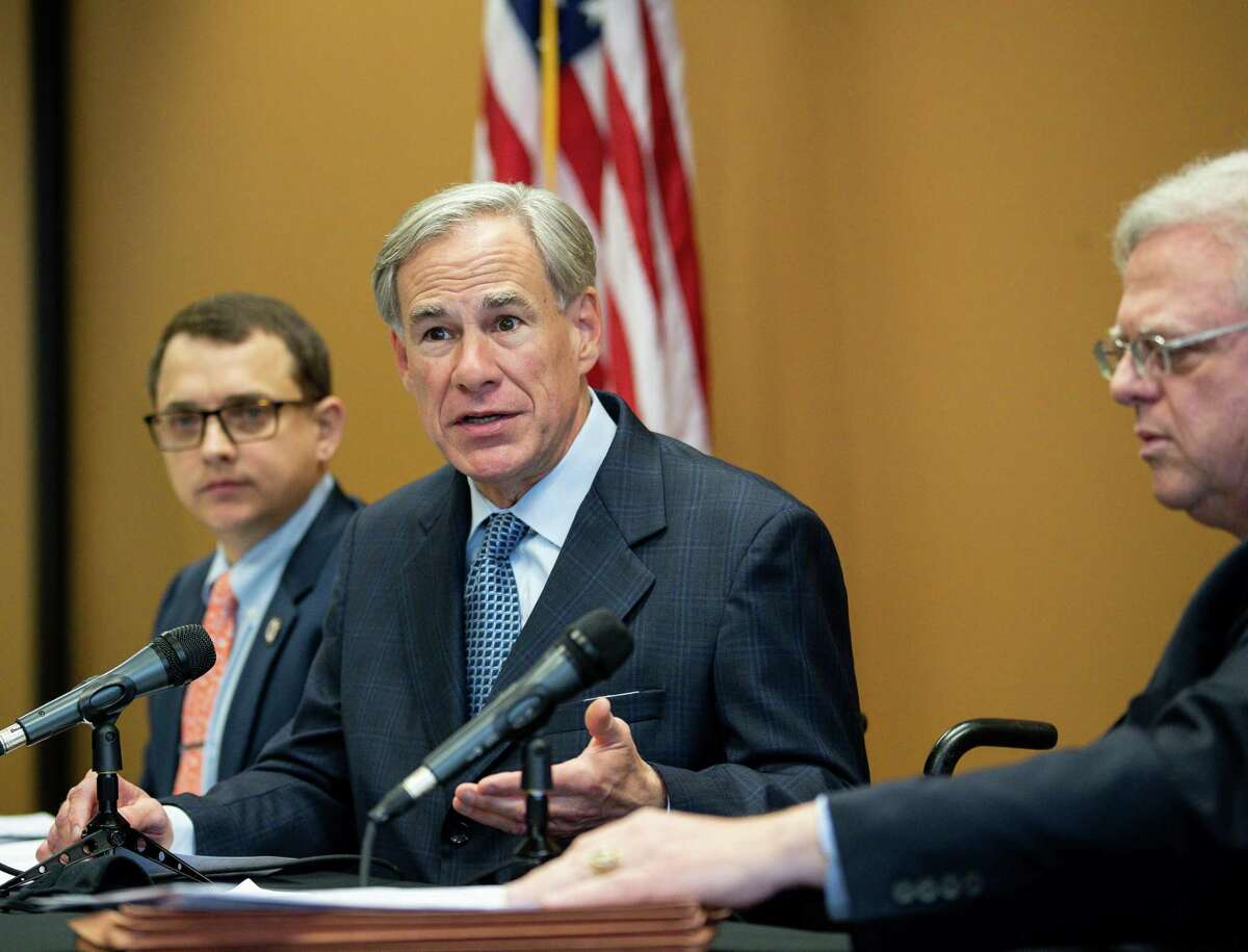 Gov. Greg Abbott talks to reporters during a press conference about a package of election reforms, at Senator Paul Bettencourt's District Office on Monday, March 15, 2021, in Houston.