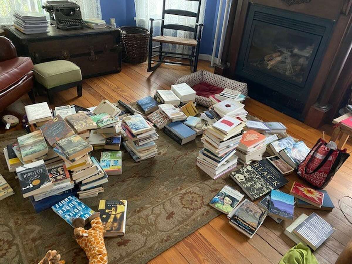 In process of organizing the books collected by Donna Liquori through the years.