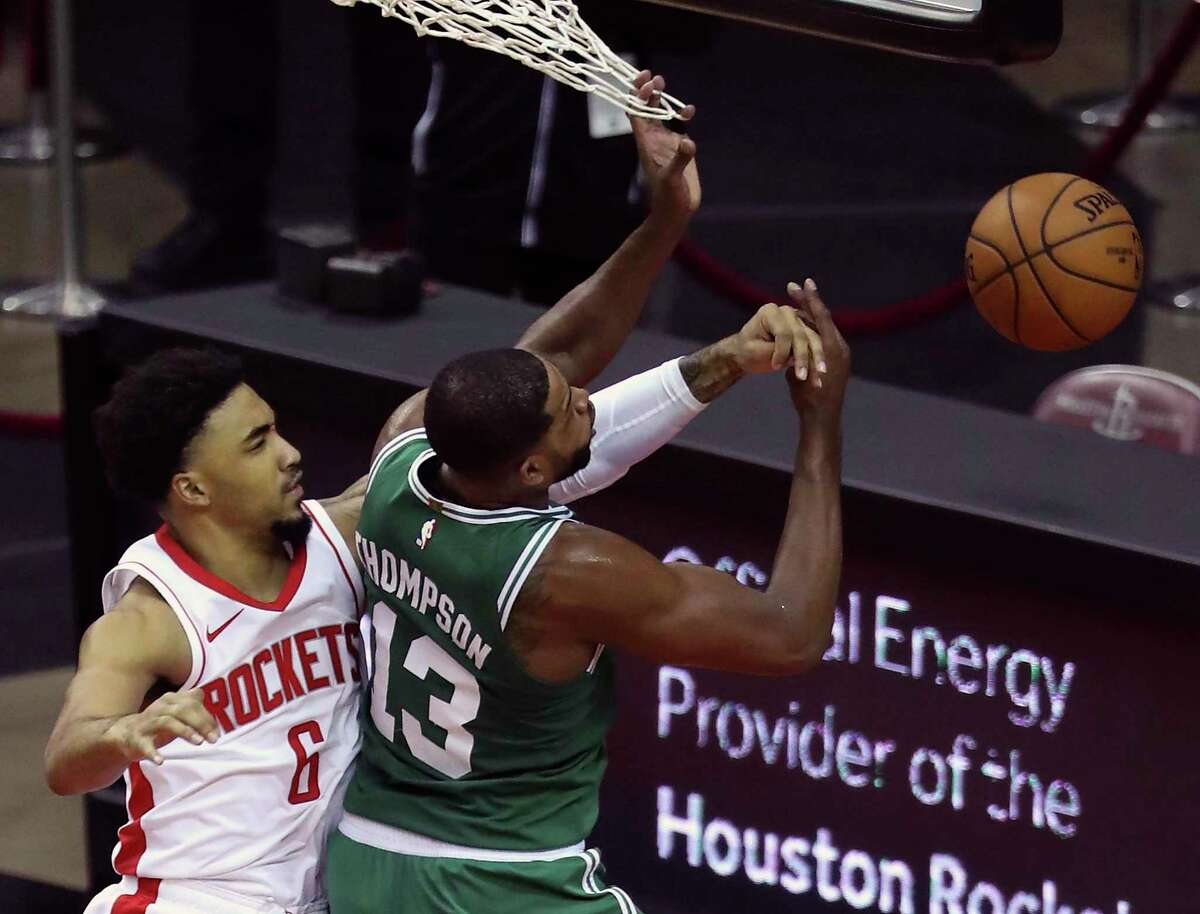 With a not-in-my-house mentality, Rockets forward K.J. Martin (6) swats away a shot by the Celtics' Tristan Thompson during a March 14 game at Toyota Center.