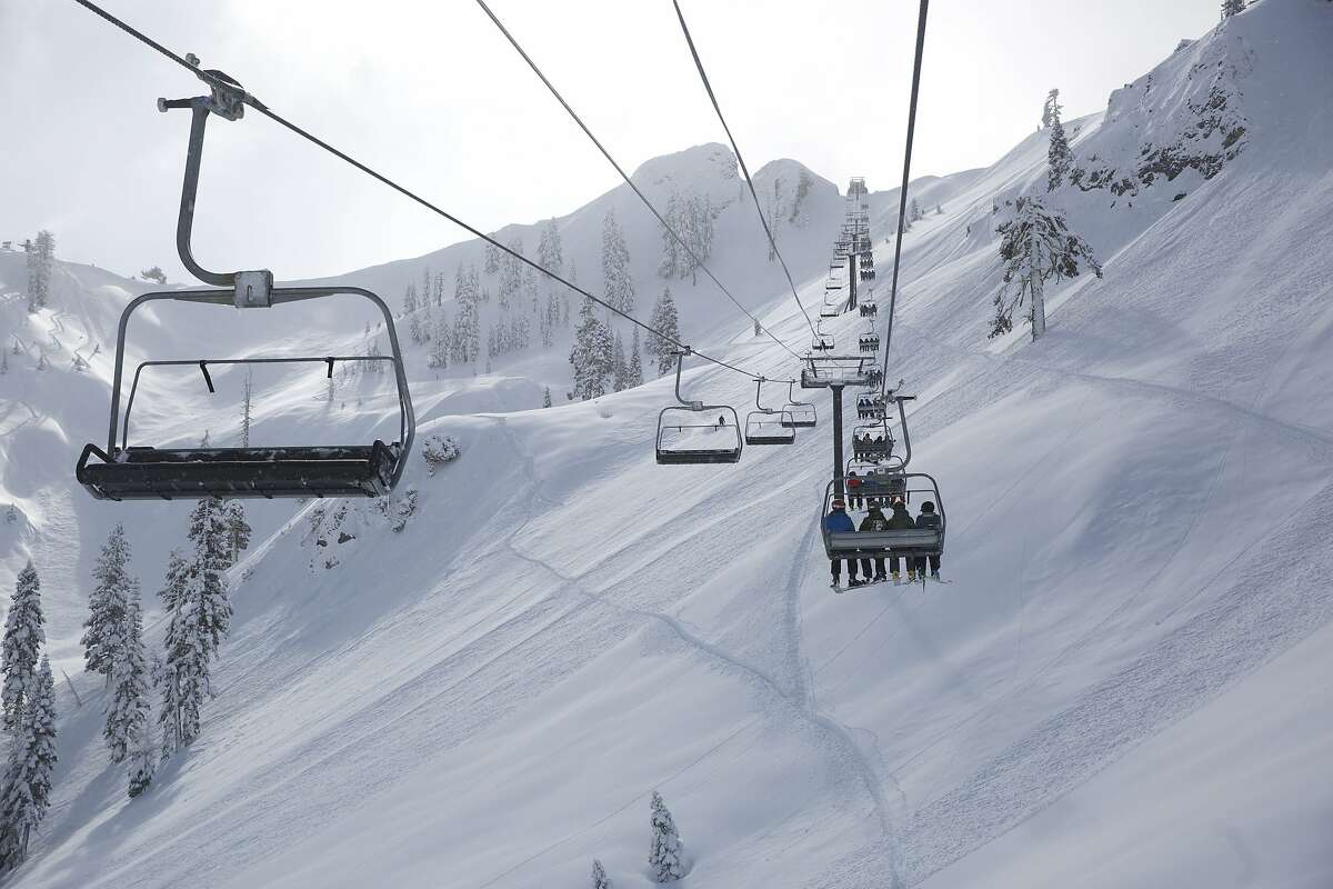 Skiers on the KT-22 chairlift at Squaw Valley in North Lake Tahoe. A new gondola connecting to Alpine Meadows via the backside of Squaw's famed KT-22 mountain, is to be built at the resorts.