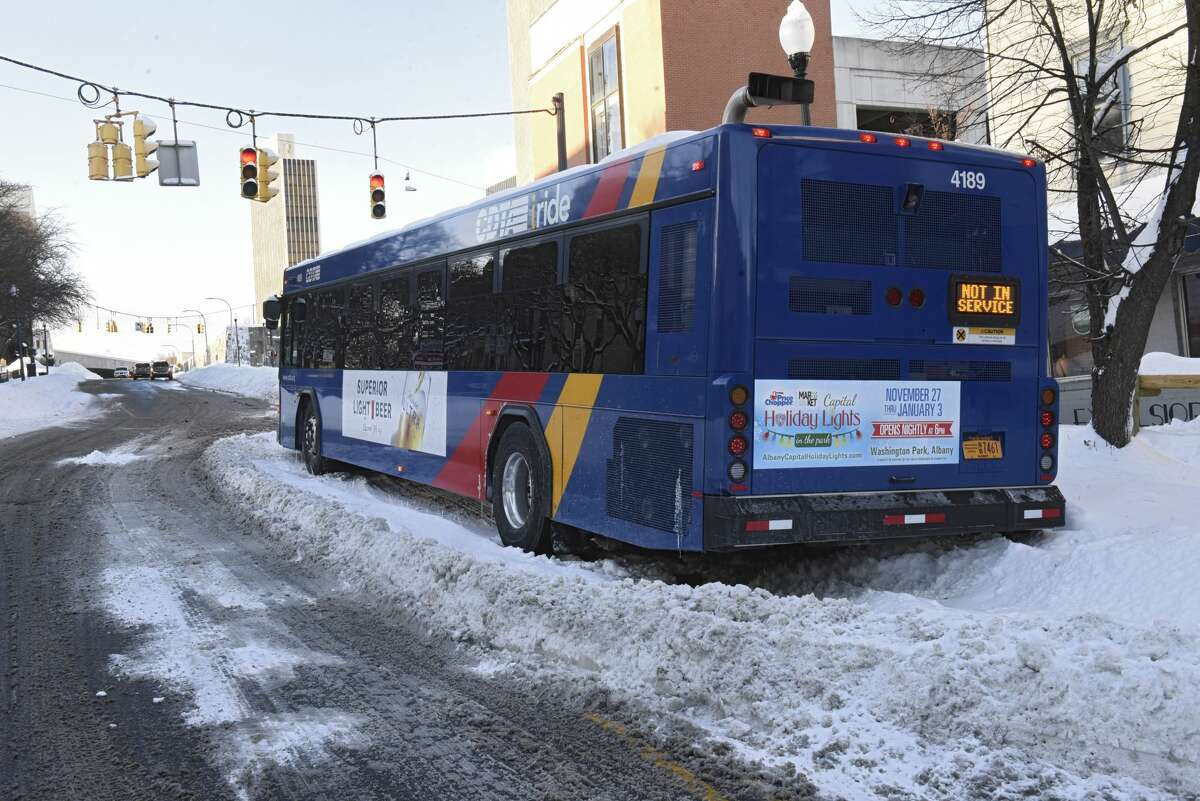 A CDTA bus is seen stuck on Madison Ave. after a nor'easter snow storm on Thursday, Dec. 17, 2020 in Albany, N.Y. (Lori Van Buren/Times Union)
