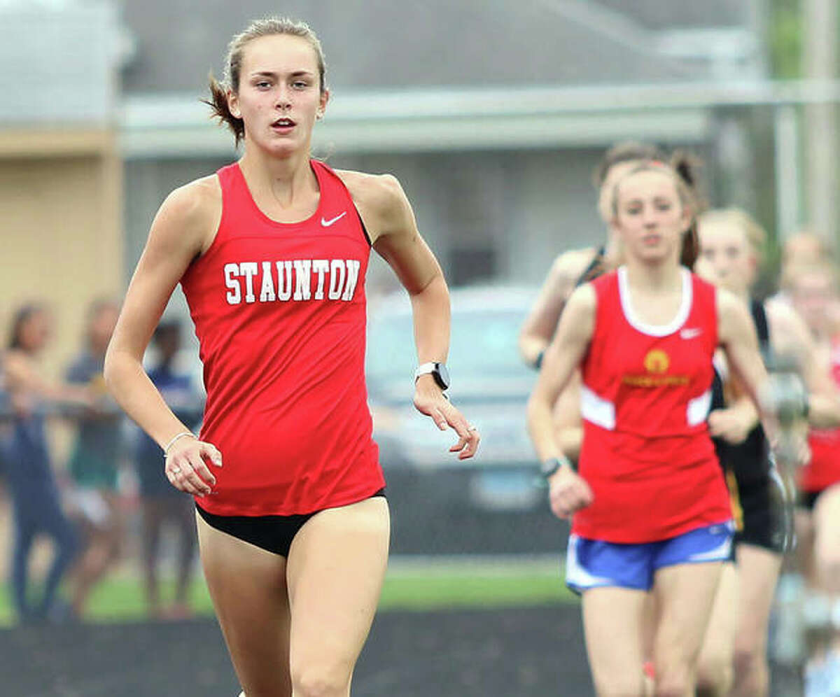 Staunton sophomore Lydia Roller (left) pulls clear of the field less than 200 meters into her first-place run in the 3,200 meters in May 2019 at the Class 2A sectional in Springfield.