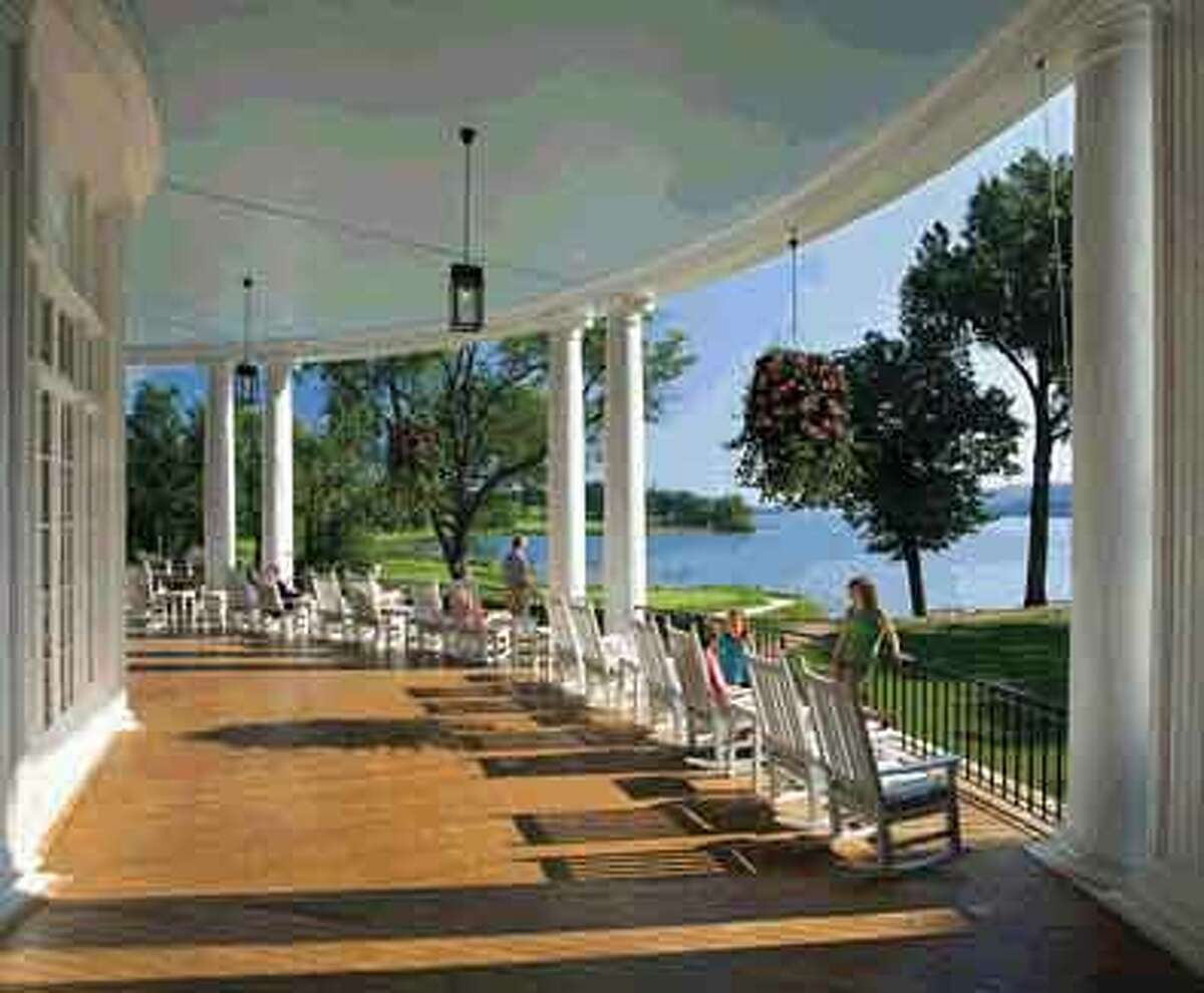 The sprawling porch of the Otesaga Resort Hotel offers views of Otsego Lake. This year, the hotel will remain open through winter.