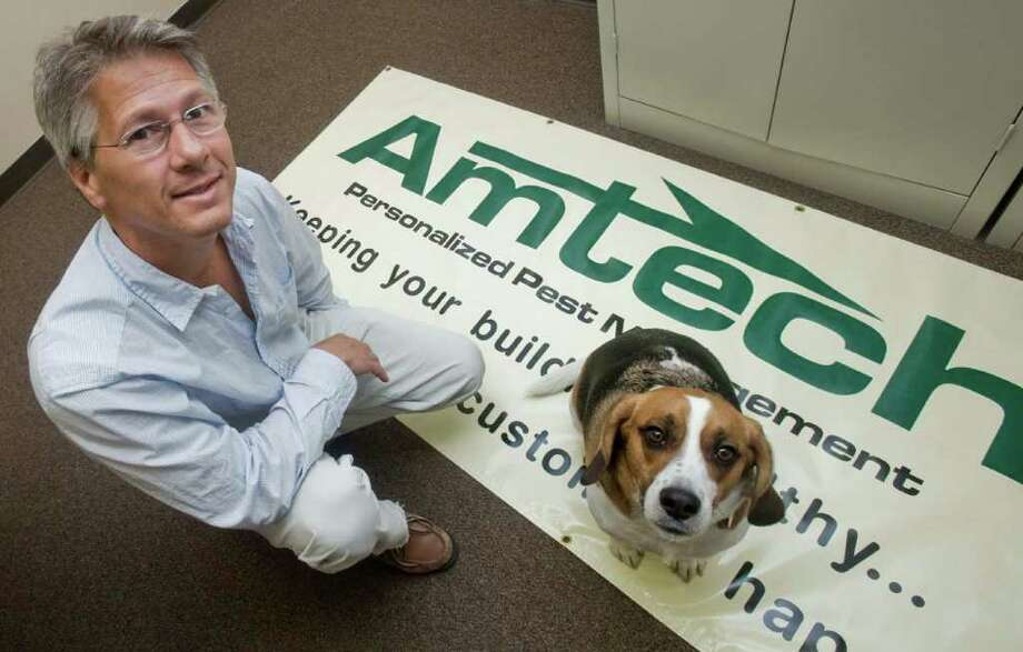Richard Monastero, owner of Amtech Pest Control in Brookfield, is shown with his dog Squirt, the 3-year-old bed-bug sniffing beagle. Photo taken Friday, Sept. 10, 2010 Photo: Scott Mullin / The News-Times Freelance