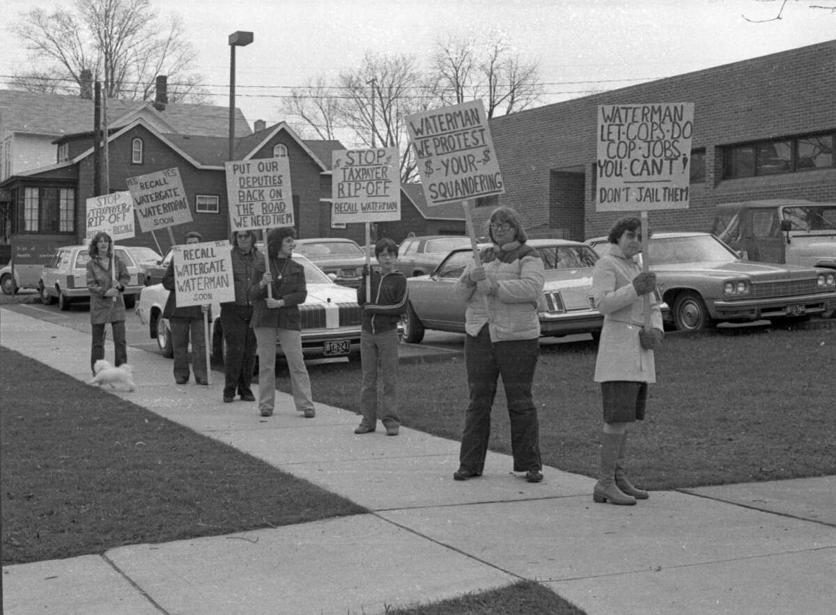 A group of people carrying pickets appeared outside the county building this morning to protest of what participants consider poor treatment of three corrections officers at the Manistee County Jail. The photo was published on the front page of the News Advocate onApril 14, 1981. (Manistee County Historical Museum photo)