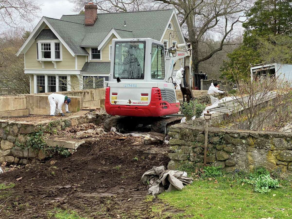 C and D Services was cleaning up the remains of the antique greenhouse at New Canaan Nature Center on April 12.