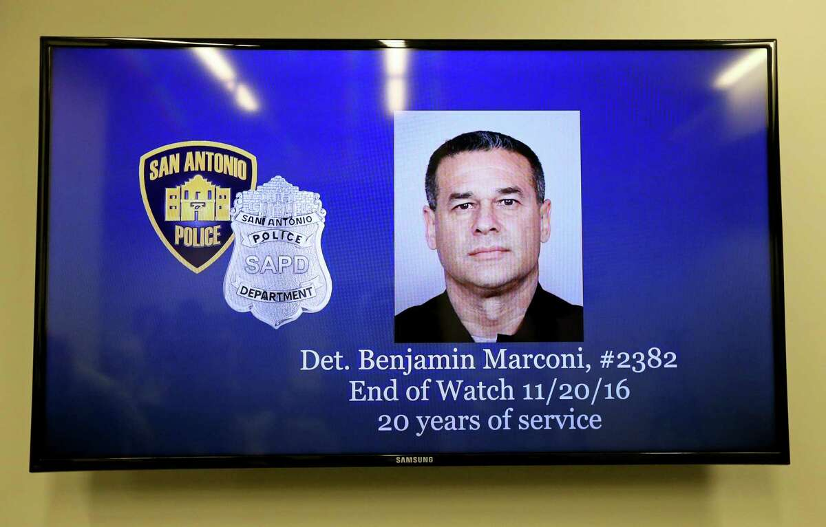 A television inside San Antonio Police Department headquarters displays the photo of Det. Benjamin Marconi, who was shot and killed while performing a routine traffic stop on Nov. 20, 2016. A trial date of July 12 has been set for Otis McKane, accused of capital murder.