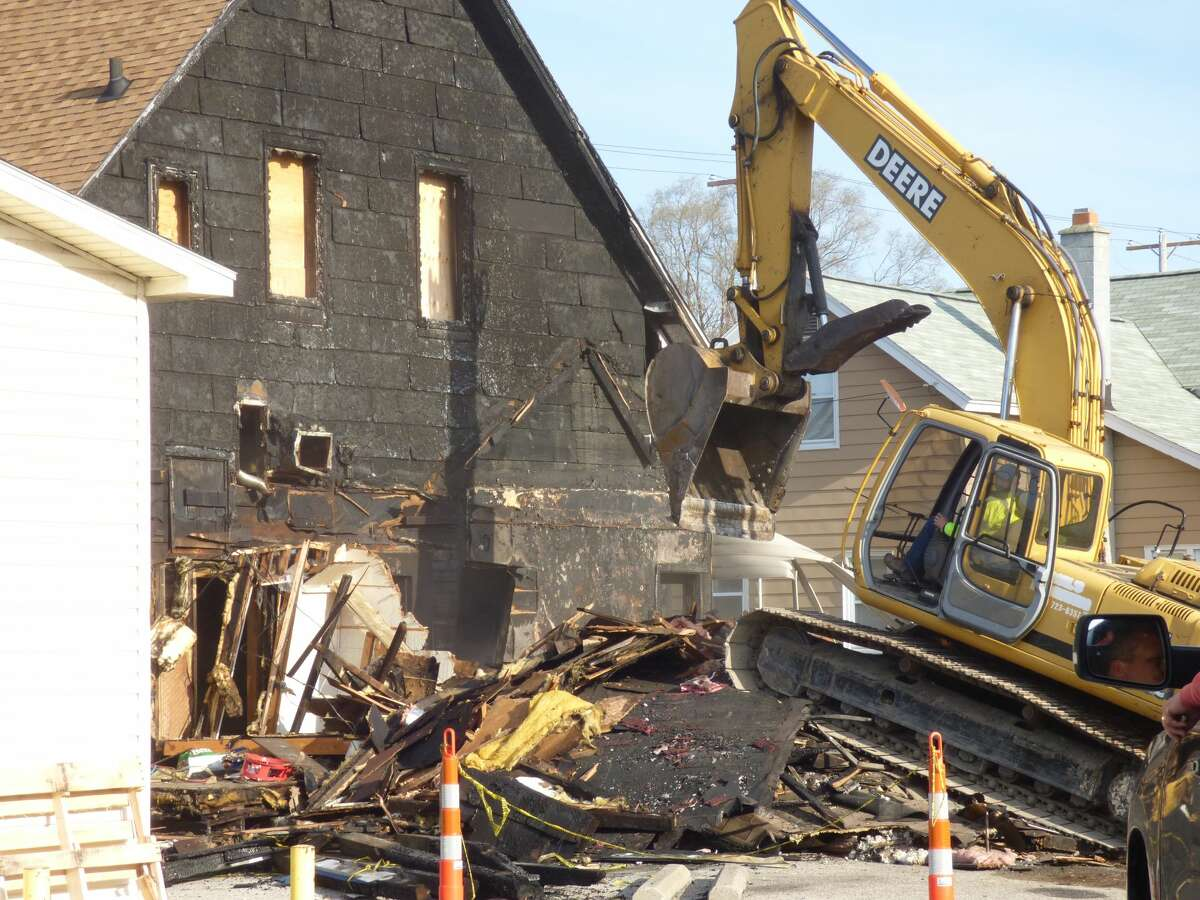 The Hi-Way Inn in Manistee's Maxwelltown neighborhood was demolished Monday following a fire last August.