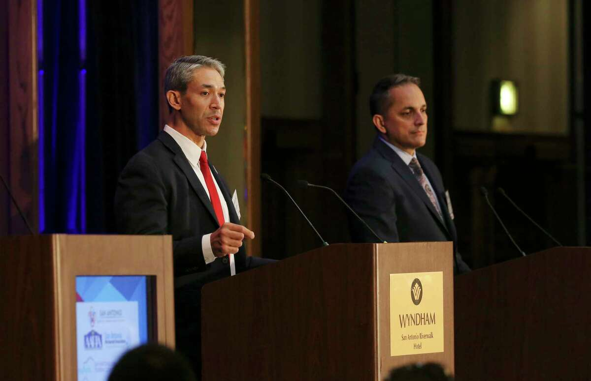 San Antonio Mayor Ron Nirenberg, left, answers a question during a mayoral debate with then-City Councilman Greg Brockhouse, right, hosted by Visit San Antonio at the Wyndham Riverwalk, Wednesday, April 3, 2019.