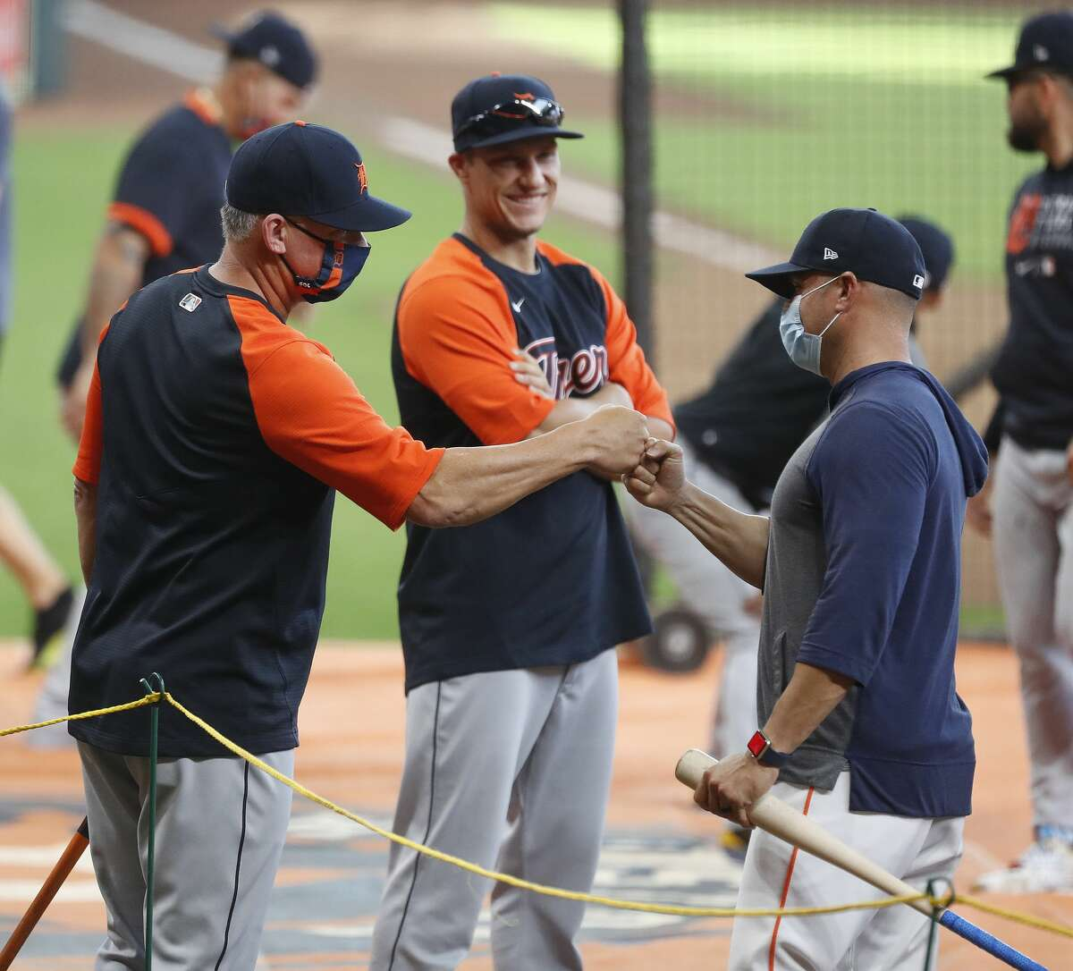 Detroit Tigers manager A.J. Hinch gives Houston Astros bench coach Joe Espada a fist bump during batting practice before the start of an MLB baseball game at Minute Maid Park, in Houston, Monday, April 12, 2021.