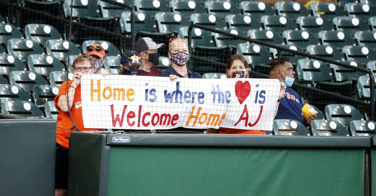 Astros fans hold up a sign for Detroit Tigers manager A.J. Hinch during batting practice before the start of an MLB baseball game at Minute Maid Park, in Houston, Monday, April 12, 2021.