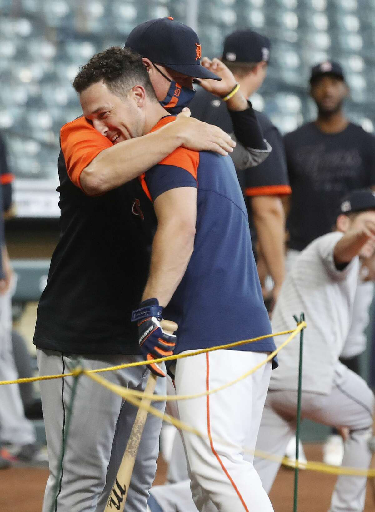 Detroit Tigers manager A.J. Hinch gives Houston Astros Alex Bregman (2) a hug during batting practice before the start of an MLB baseball game at Minute Maid Park, in Houston, Monday, April 12, 2021.