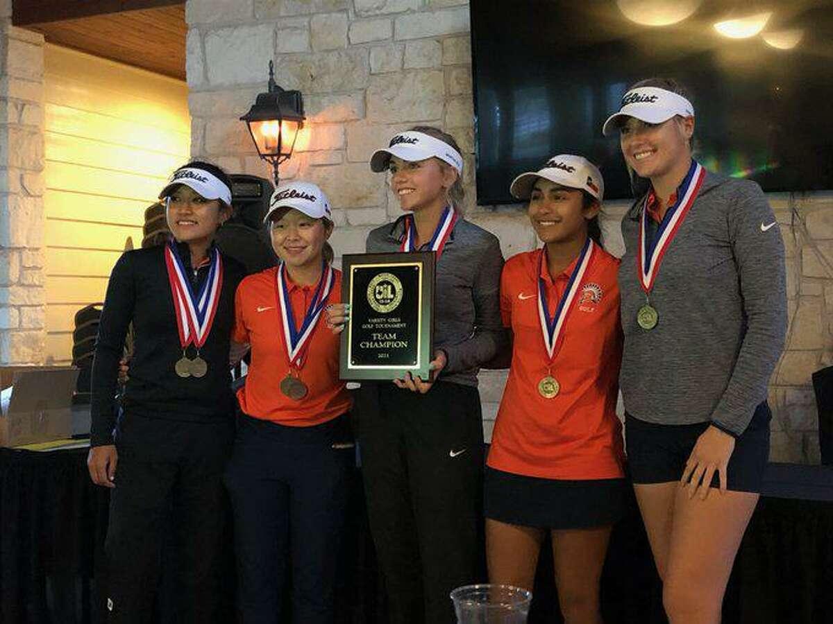The Seven Lakes girls golf team of individual champion Lauren Nguyen, Maelynn Kim, Grayson Heilman, Floortje Rademaker and Krisna Mahendran won the District 19-6A championship.