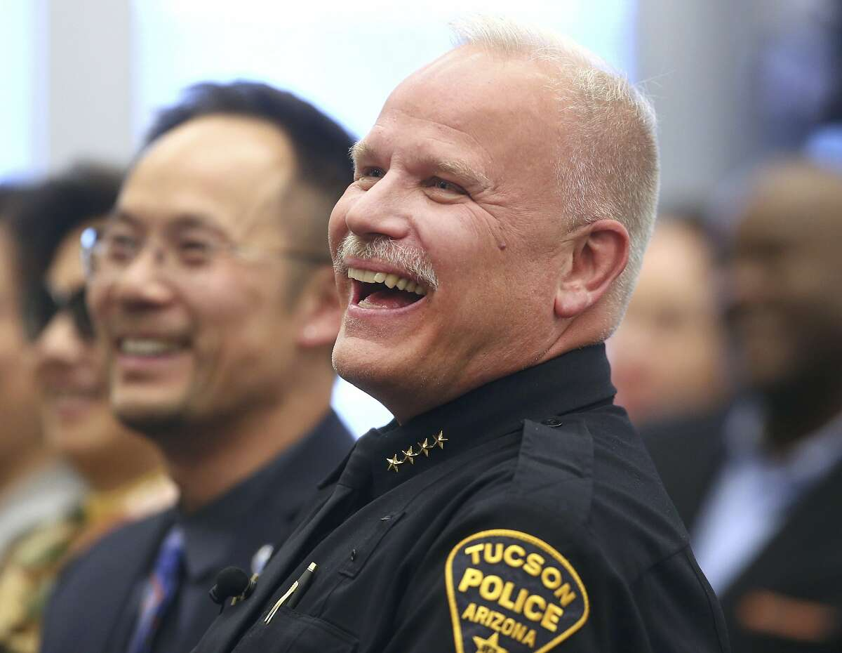 Tucson Police Chief Chris Magnus smiles and laughs during his swearing-in ceremony at the Westside Police Service Center in Tucson, Ariz., on March 30, 2016. President Joe Biden is nominating Magnus to be commissioner of Customs and Border Protection.