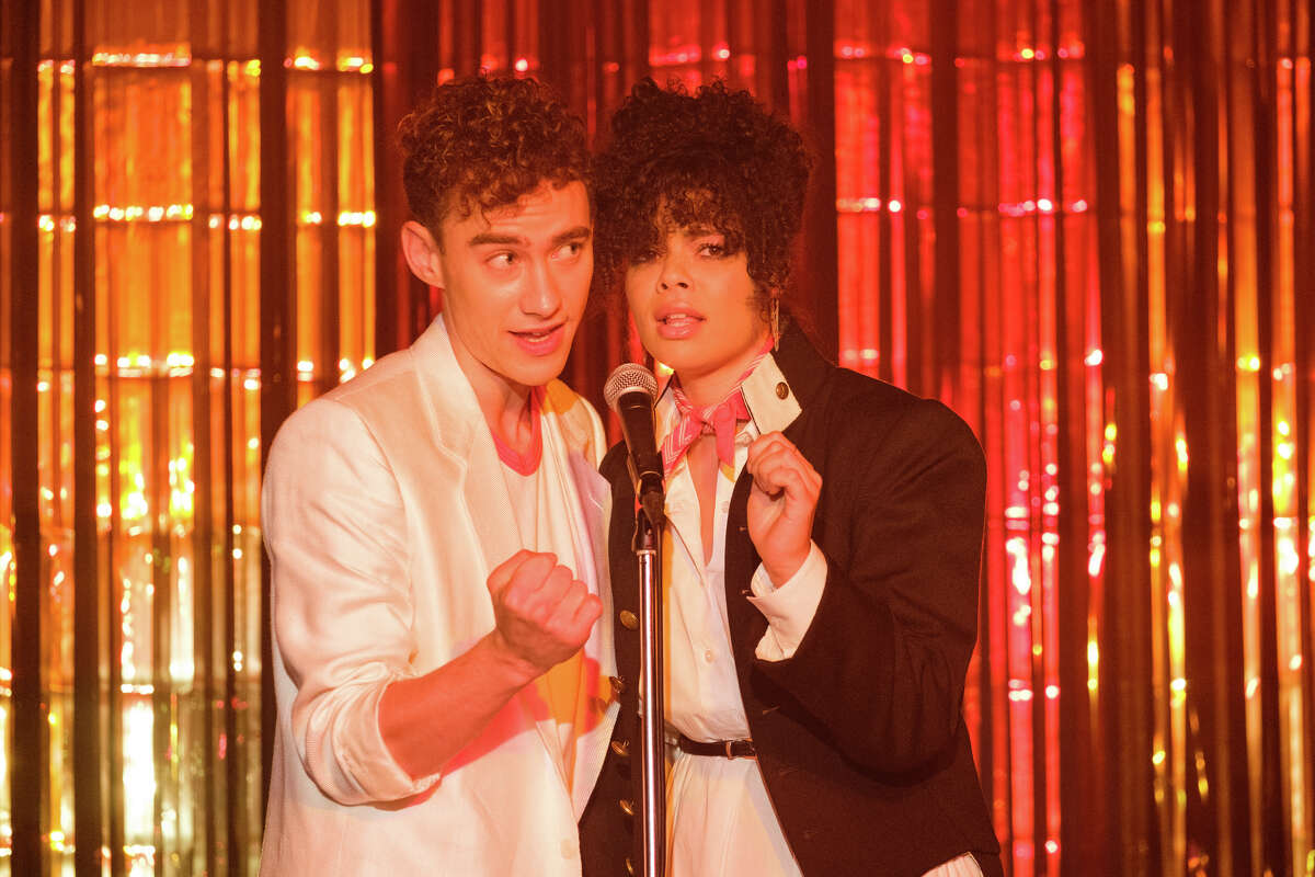 """Olly Alexander as Ritchie Tozer and Lydia West as Jill Baxter in """"It's a Sin"""" on HBO Max."""