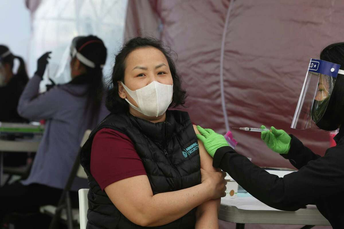 Phuong Nguyen of San Leandro receives a Johnson and Johnson COVID-19 vaccine at a pop-up clinic.