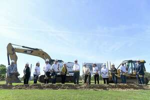 Nederland school board members gather with Mayor Don Albanese, Principal Natalie Gomez and others for a groundbreaking ceremony Monday as work for the new high school begins. Photo made Monday, April 12, 2021 Kim Brent/The Enterprise
