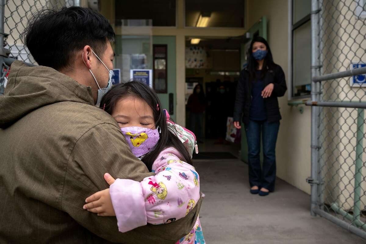 William Luong sees off daughter Evelyn, 4, before her first day at Jefferson Early Education School in the Sunset.