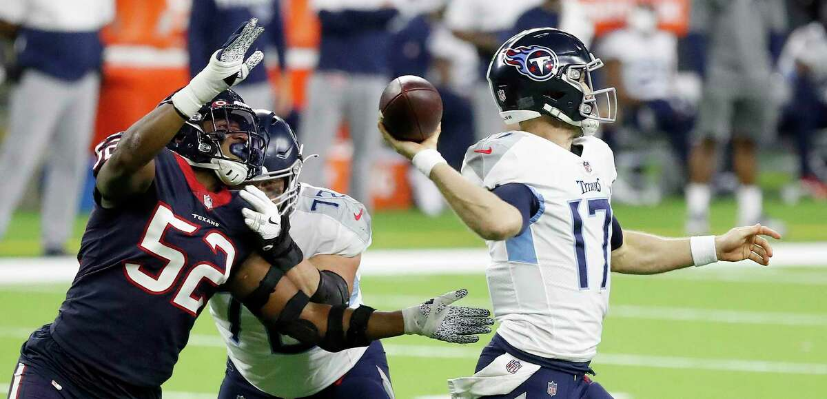Texans linebacker Jonathan Greenard, trying to sack Ryan Tannehill, could move to defensive end in Lovie Smith's 4-3 defense.