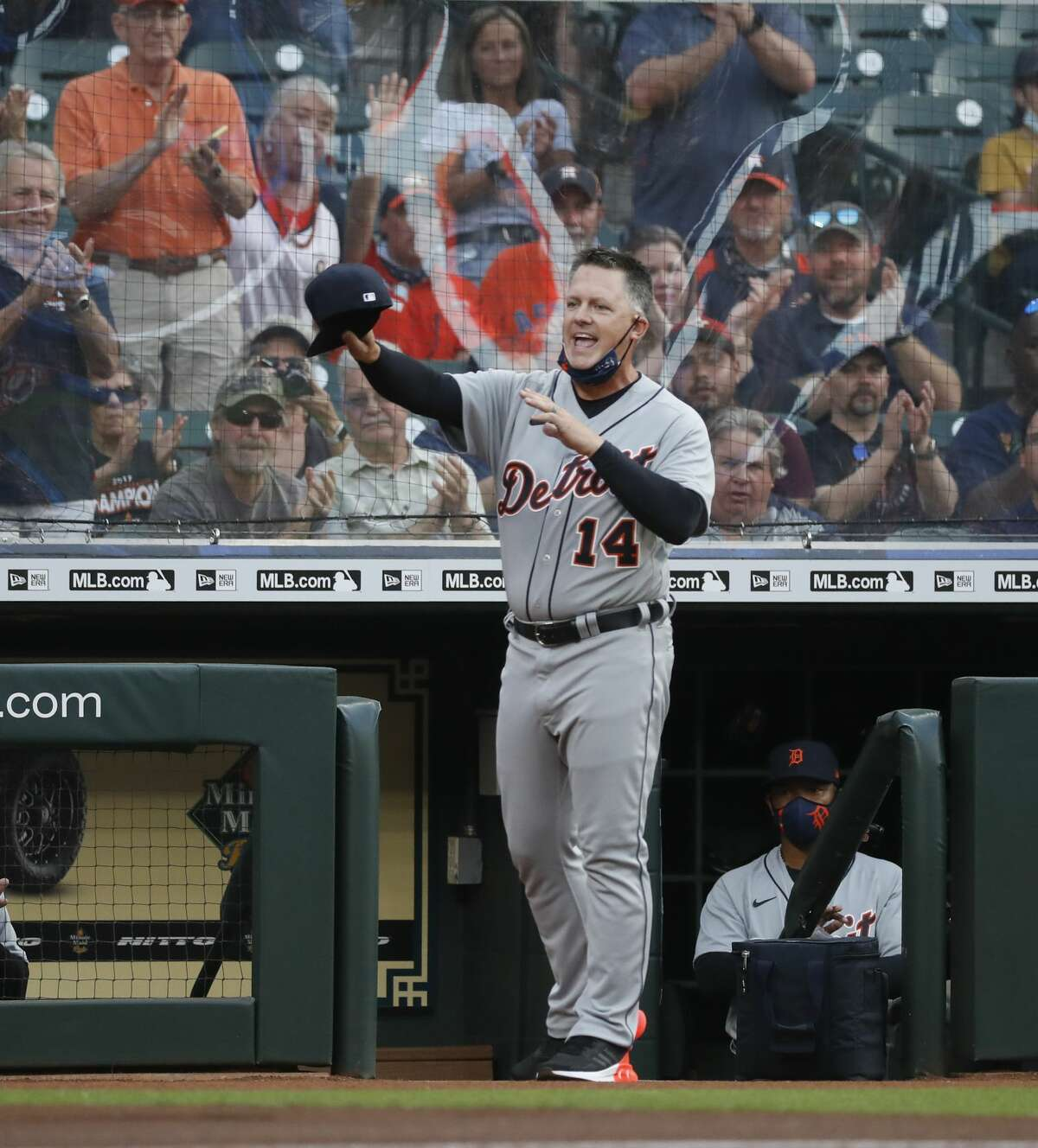 Detroit Tigers manager A.J. Hinch (14) tips his cap to the cheering Houston Astros fans before the start of the first inning of an MLB baseball game at Minute Maid Park, in Houston, Monday, April 12, 2021.