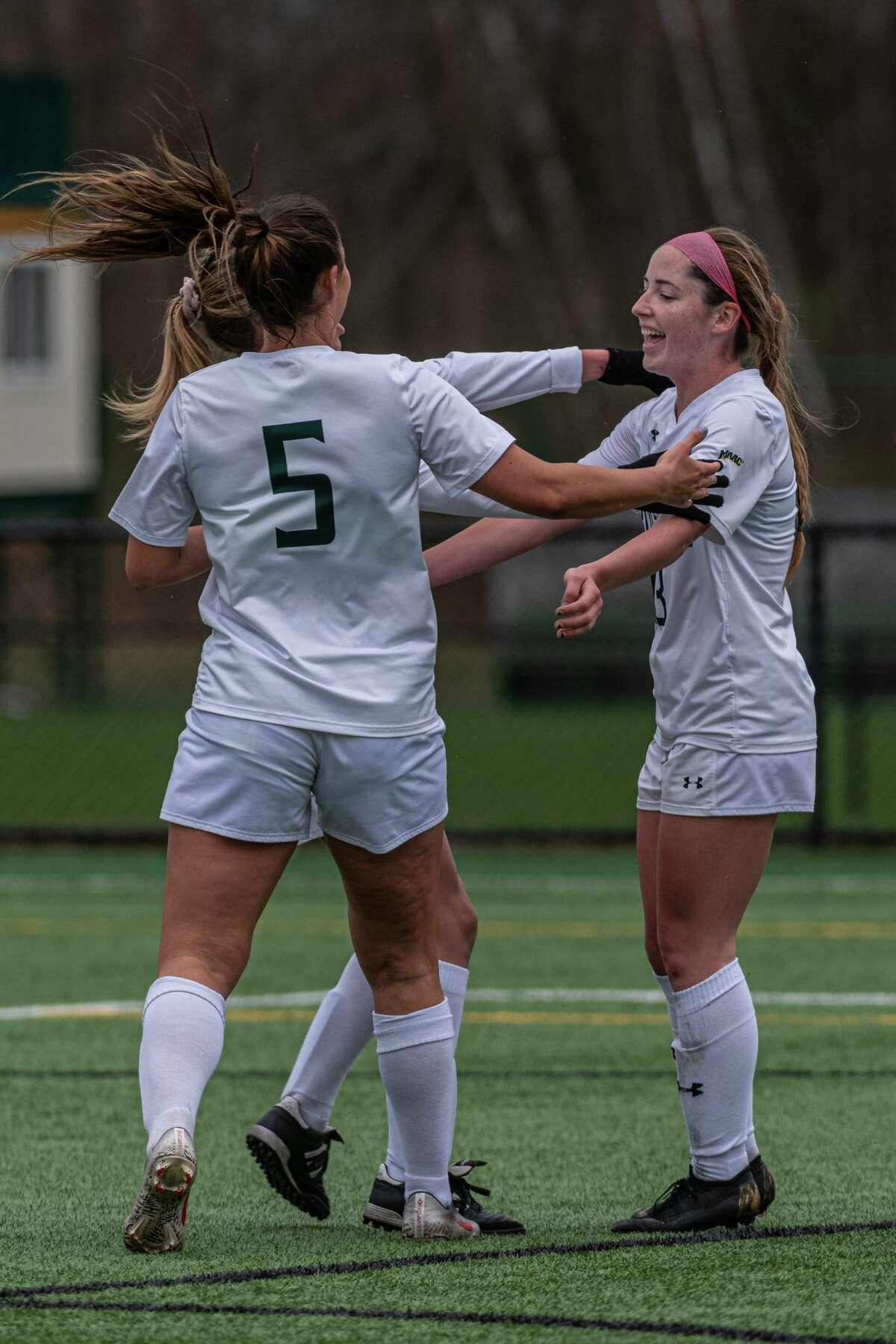 Siena's Carrie Krohn, right,celebrates with teammates after her goal against Rider in their MAAC Tournament semifinal on Monday, April 12, 2021. (Robert Simmons / Siena Athletics)