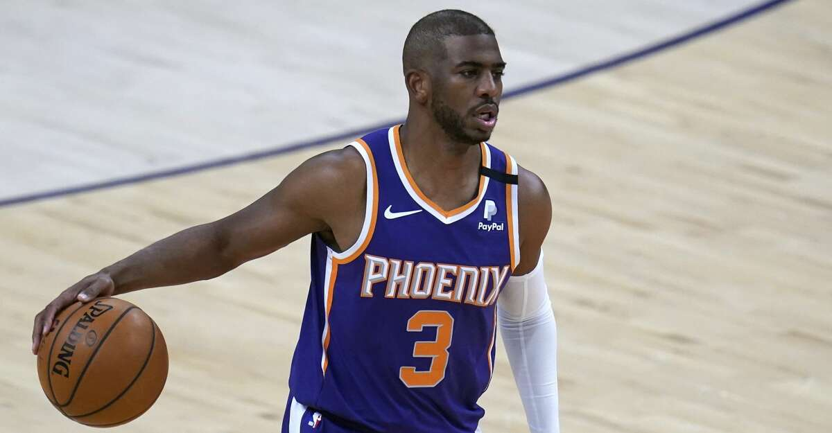Phoenix Suns guard Chris Paul dribbles against the Chicago Bulls during the first half of an NBA basketball game Wednesday, March 31, 2021, in Phoenix. (AP Photo/Ross D. Franklin)