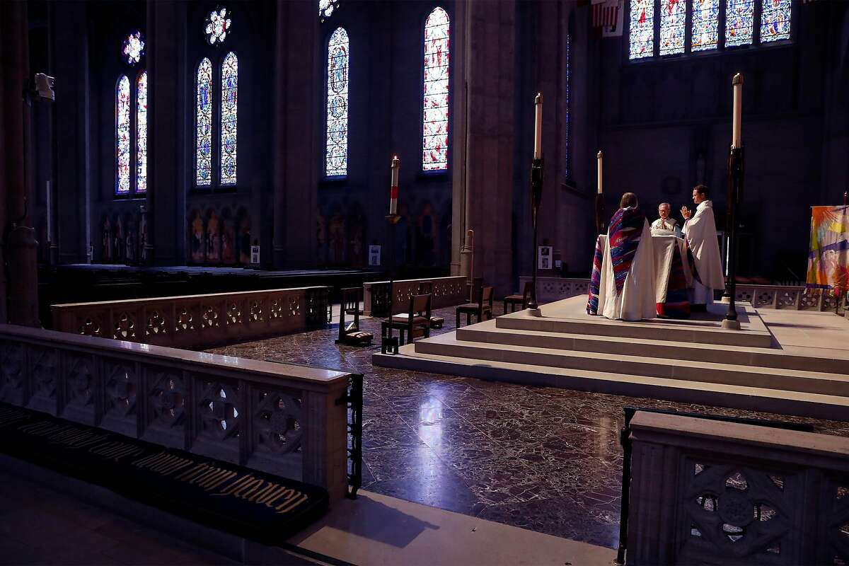 (right to left) Dean Malcolm Young, Bishop Marc Andrus and Vice Dean Ellen Clark-King during virtual Easter Sunday service at Grace Cathedral in San Francisco, Calif., on Sunday, April 12, 2020.