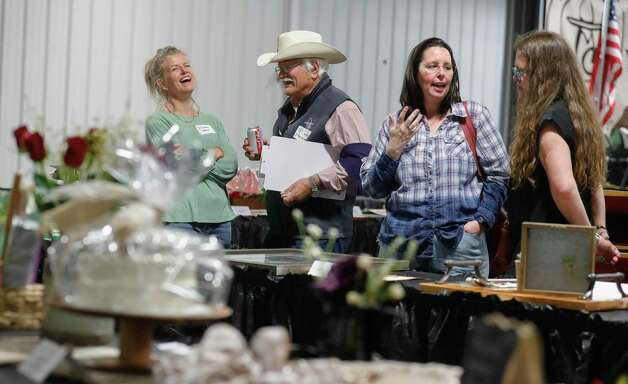 Darla Weaver laughs beside Ray Steinman before the non-livestock auction at the Montgomery County Fair and Rodeo, Monday, April 12, 2021, in Conroe. Photo: Jason Fochtman, Houston Chronicle / Staff Photographer / 2021 © Houston Chronicle