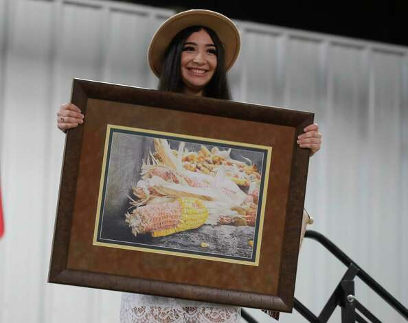 Kaylie Garcia of Porter High School won grand champion fine art for her colored pencil piece during the non-livestock auction at the Montgomery County Fair and Rodeo, Monday, April 12, 2021, in Conroe. Photo: Jason Fochtman, Houston Chronicle / Staff Photographer / 2021 © Houston Chronicle